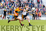 Colin Griffin Austin Stacks in action against Kieran O'Leary Dr Crokes in the Kerry Club Championship Final on Sunday.