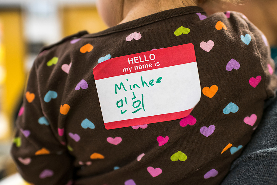 Minhee's name tag – written in English and Korean – is pictured during a lunar new year event hosted by Families Through Korean Adoption (FTKA) in the gym and school cafeteria of St. Dennis Church in Madison, Wis., on Feb. 10, 2018. The event celebrated the passing of the lunar new year, and is one of several events for FTKA-member families and children to gather and enjoy cultural fun, food and play. (Photo by Jeff Miller - www.jeffmillerphotography.com)