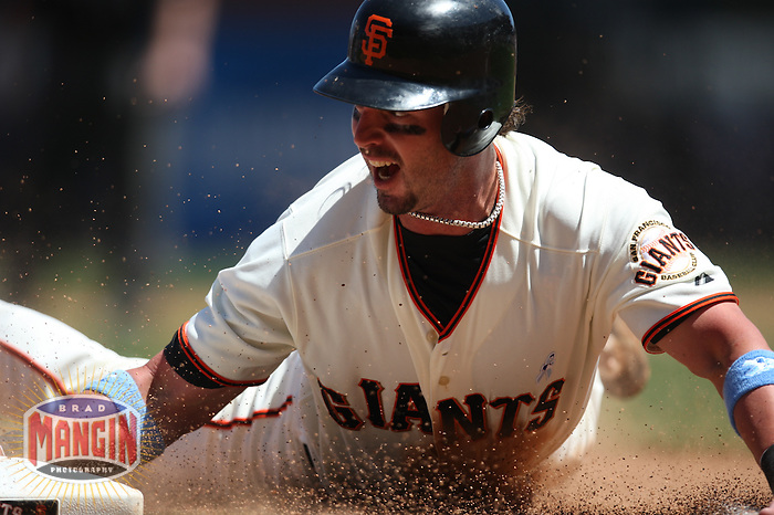 SAN FRANCISCO - JUNE 21:  Aaron Rowand #33 of the San Francisco Giants slides safely into third base after going first to third on a single in the seventh inning against the Texas Rangers during the game at AT&T Park on June 21, 2009 in San Francisco, California. Photo by Brad Mangin