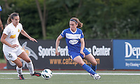 Boston Breakers midfielder Heather O'Reilly (9) dribbles as Western New York Flash defender Katherine Reynolds (16) defends. In a National Women's Soccer League Elite (NWSL) match, the Boston Breakers (blue) tied Western New York Flash (white), 2-2, at Dilboy Stadium on June 5, 2013.