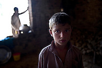 A refugee from Swat district shelters with his family in a derelict house in neighbouring Swabi district. The Pakistani government began an offensive against the Taliban in the Swat Valley in April 2009, which led to a major humanitarian crisis. Up to two million civilians were estimated to have been displaced by the fighting.