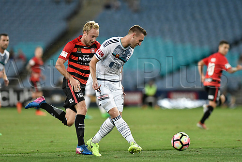 April 8th 2017, ANZ Stadium, Sydney, Australia; A-League football, Western Sydney Wanderers versus Melbourne Victory; Victory defender Nick Ansellunder pressure from Wanderers midfielder Mitch Nichols; The match  ended in a 0-0 draw;