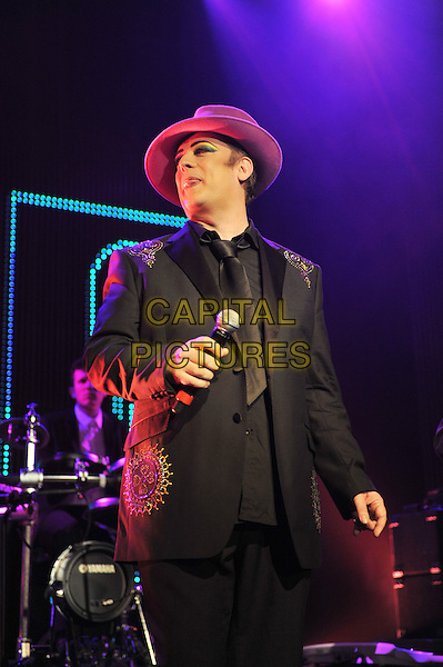 Boy George (George Alan O'Dowd).British Electric Foundation (B.E.F) at the Roundhouse, Camden, London, England..15th October 2011.performing performance live in stage on concert music gig half length black suit purple hat   .CAP/MAR.© Martin Harris/Capital Pictures.