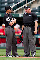 Home Plate Umpire Tom Svehla talks with First Base umpire Mark Wagers during a game between the Bradley Braves and the Missouri State Bears on May 13, 2011 at Hammons Field in Springfield, Missouri.  Photo By David Welker/Four Seam Images.