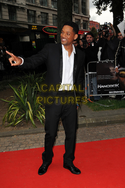 "WILL SMITH .Attending the UK Gala Premiere of ""Hancock"" held at the Vue West End, Leicester Square, London, England..June 18th 2008.full length black suit white shirt hand .CAP/CAS.©Bob Cass/Capital Pictures."