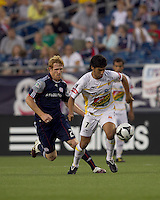 Monarcas Morelia forward Rafael Marquez Lugo (7) settles the ball as New England Revolution defender Pat Phelan (28) closes. The New England Revolution defeated Monarcas Morelia in SuperLiga 2010 group stage match, 1-0, at Gillette Stadium on July 20, 2010.