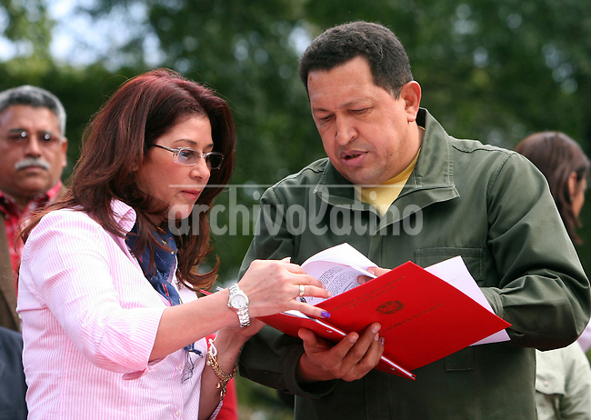 Venezuelan President Hugo Chavez receives from National Assembly President Cilia Flores the results of the latest referendum in Caracas February 19, 2009. Chavez's referendum win puts him closer to his goal of ruling for another decade or more