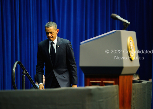 """United States President Barack Obama walks up to the podium to deliver his speech at the event """"Together We Thrive: Tucson and America"""" honoring the January 8 shooting victims at McKale Memorial Center on the University of Arizona campus on Wednesday, January 12, 2011 in Tucson, Arizona. The memorial service is in honor of victims of the mass shooting at a Safeway grocery store that killed six and injured at least 13 others, including U.S. Representative Gabrielle Giffords (Democrat of Arizona), who remains in critical condition after being shot in the head. Among those killed were U.S. District Judge John Roll, 63; Giffords' director of community outreach, Gabe Zimmerman, 30; and 9-year-old Christina Taylor Green. .Credit: Kevork Djansezian / Pool via CNP"""