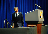 "United States President Barack Obama walks up to the podium to deliver his speech at the event ""Together We Thrive: Tucson and America"" honoring the January 8 shooting victims at McKale Memorial Center on the University of Arizona campus on Wednesday, January 12, 2011 in Tucson, Arizona. The memorial service is in honor of victims of the mass shooting at a Safeway grocery store that killed six and injured at least 13 others, including U.S. Representative Gabrielle Giffords (Democrat of Arizona), who remains in critical condition after being shot in the head. Among those killed were U.S. District Judge John Roll, 63; Giffords' director of community outreach, Gabe Zimmerman, 30; and 9-year-old Christina Taylor Green. .Credit: Kevork Djansezian / Pool via CNP"