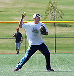 Jesse Tuttle throws to first during the No Crying in Softball Tournament.  Photo by Tom Smedes.