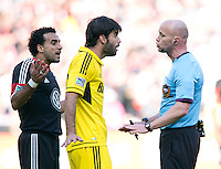 Agustin Viana (24) of the Columbus Crew and Dwayne De Rosario (7) of D.C. United argue with referee Allen Chapman during the game at RFK Stadium in Washington, DC.  Columbus Crew defeated D.C. United, 2-1.