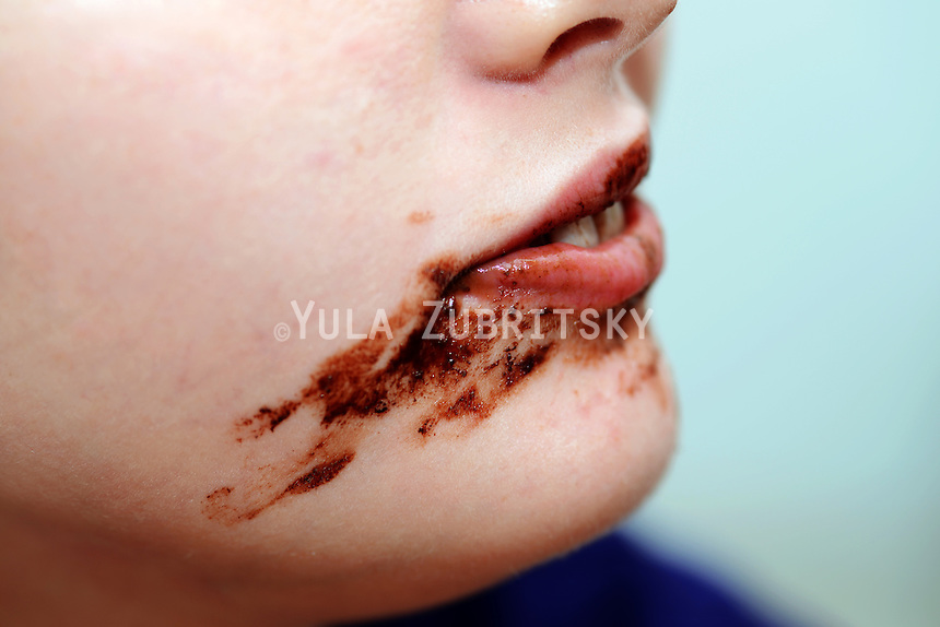 Messy face eating Chocolate