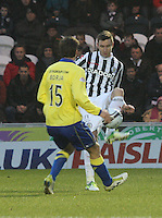 Paul Dummett closed down by Borja Perez in the St Mirren v Kilmarnock Clydesdale Bank Scottish Premier League match played at St Mirren Park, Paisley on 2.1.13.