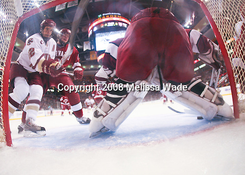 Dan Bertram (BC 22) moves in with Alex Biega (Harvard 3) right behind. The Boston College Eagles defeated the Harvard University Crimson 6-5 in overtime on Monday, February 11, 2008, to win the 2008 Beanpot at the TD Banknorth Garden in Boston, Massachusetts.