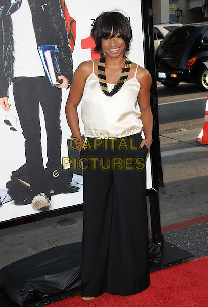 "MONIQUE COLEMAN.The L.A. premiere of ""17 Again"" held at The Grauman's Chinese Theatre in Hollywood, California, USA. .April 14th, 2009.full length white top black trousers wide leg flared hands in pockets necklace .CAP/DVS.©Debbie VanStory/Capital Pictures."