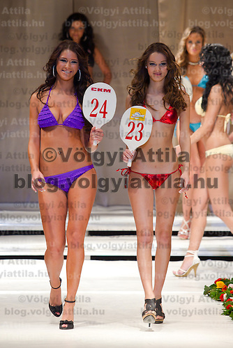 Renata Nemes (left) and Bettina Balavaider (right) attends the Miss Hungary 2010 beauty contest held in Budapest, Hungary on November 29, 2010. ATTILA VOLGYI