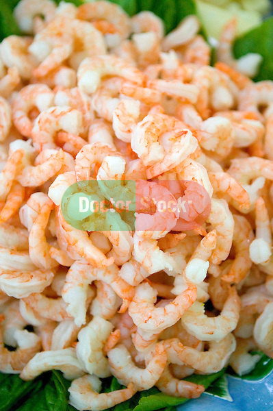 a pile of cooked shrimp ready for eating