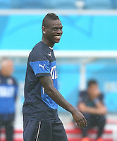 Mario Balotelli of Italy laughs as he jokes around during training ahead of tomorrow's Group D match vs Uruguay