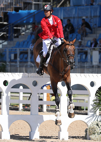 14.08.2016. Rio de Janeiro, Brazil. Taizo Sugitani of Japan on horse Imothep clears an obstacle during the Jumping Team 1st Qualifier of the Equestrian competition at the Olympic Equestrian Centre during the Rio 2016 Olympic Games in Rio de Janeiro, Brazil, 14 August 2016.