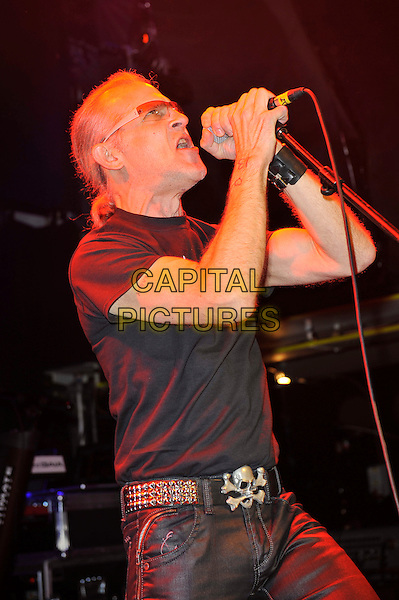 Ivan Doroschuk of Men Without Hats.Performing in concert, Islington Academy, London, England, UK, .1st February 2013..music live on stage concert gig half length black t-shirt glasses microphone singing .CAP/MAR.© Martin Harris/Capital Pictures.