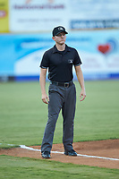Third base umpire Trevor Matthews works the Appalachian League playoff game between the Burlington Royals and the Pulaski Yankees at Calfee Park on August 31, 2019 in Pulaski, Virginia. The Yankees defeated the Royals 6-0. (Brian Westerholt/Four Seam Images)