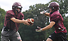 Ryan Aughavin, North Shore quarterback, left, prepares to hand off during varsity football team practice at North Shore High School in Glen Head on Thursday, Aug. 18, 2016.