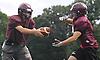 Ryan Aughavin, North Shore quarterback, left, prepares to hand off during varsity football team practice at North Shore High School in Glen Head on Thursday, Aug. 18, 2016.