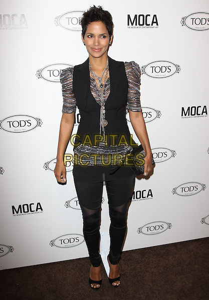 HALLE BERRY.Tod's Beverly Hills boutique Grand Opening held At Tod's Boutique, Beverly Hills, California, USA. .April 15th, 2010 .full length silver grey gray sheer puff leggings jeggings sleeve top waistcoat black vest clutch bag necklace sheer striped shiny .CAP/ADM/KB.©Kevan Brooks/AdMedia/Capital Pictures.