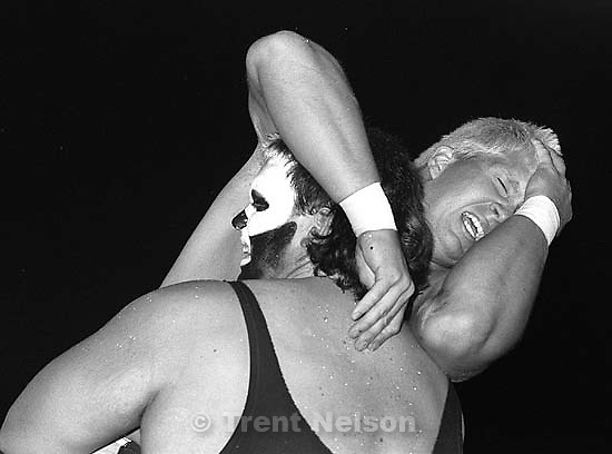 Action at professional wrestling match.<br />