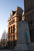 Old City HAll Toronto in sunlight with memorial in fore ground