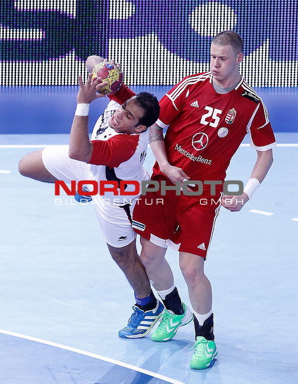 Hungary's Szabolcs Zubai (r) and Egypt's Mohamed Ahmed during 23rd Men's Handball World Championship preliminary round match.January 12 ,2013. Foto © nph / Acero)