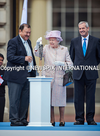 THE QUEEN<br /> launched The Queen's Baton Relay for the XX Glasgow Commonwealth Games from the forecourt of Buckingham Palace_9/10/2013<br /> The baton was carried down the Mall towards the Palace by Sir Chris Hoy and was presented to Her Majesty The Queen, Head of the Commonwealth. <br /> The Queen was accompanied by the Duke of Edinburgh, HRH Prince Imran &sbquo;President of the Commonwealth Games Federation and the Rt Hon Lord Smith of Kelvin &sbquo;Chairman of the Glasgow 2014 Organising Committee.  <br /> In keeping with tradition, The Queen placed a personal message inside the baton, which will be reopened at the Opening Ceremony of the Games in Glasgow, Scotland, next year, when the message will then be read out to all the nations and territories of the Commonwealth.  <br /> Mandatory Credit Photo: &copy;Harlen/NEWSPIX INTERNATIONAL<br /> <br /> **ALL FEES PAYABLE TO: &quot;NEWSPIX INTERNATIONAL&quot;**<br /> <br /> IMMEDIATE CONFIRMATION OF USAGE REQUIRED:<br /> Newspix International, 31 Chinnery Hill, Bishop's Stortford, ENGLAND CM23 3PS<br /> Tel:+441279 324672  ; Fax: +441279656877<br /> Mobile:  07775681153<br /> e-mail: info@newspixinternational.co.uk