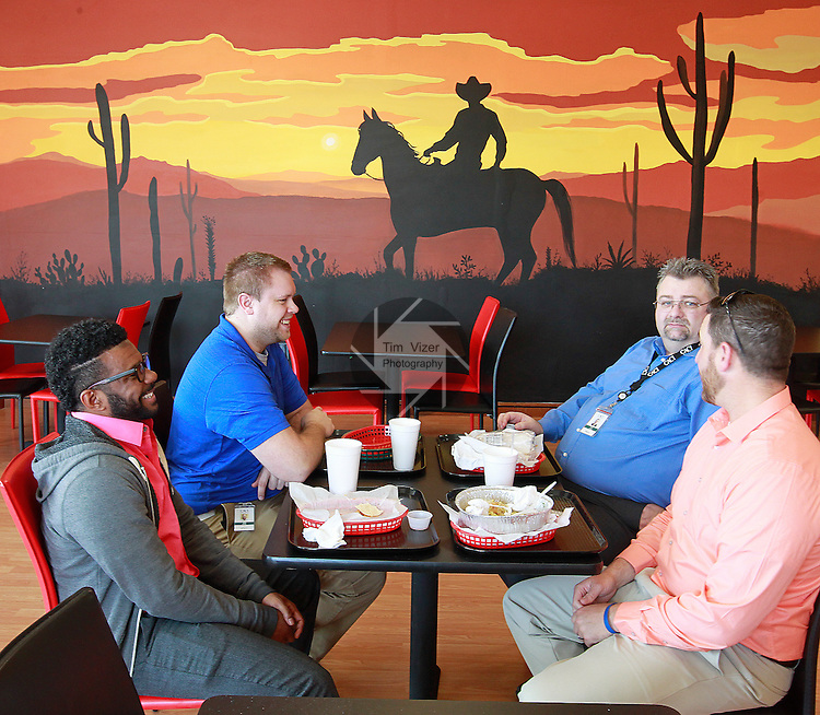 A new Mexican eatery, Taqueria Olvera, under the ownership of Manny Olvera, has opened at 341 Market Place in Fairview Heights. Customers wrap up their lunch on Wednesday March 25. In the background is a wall-size mural which was drawn by a Smithton artist.