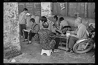 A family enjoys lunch in the old section of Lianzhou in southern China's Guangdong province, 2015.
