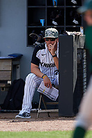 UCF Knights head coach Greg Lovelady (23) in the dugout during a game against the Siena Saints on February 17, 2019 at John Euliano Park in Orlando, Florida.  UCF defeated Siena 7-1.  (Mike Janes/Four Seam Images)