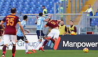 Calcio, Serie A: Roma vs Lazio. Roma, stadio Olimpico, 8 novembre 2015.<br /> Roma's Edin Dzeko, right, is fouled by Lazio's Santiago Gentiletti during the Italian Serie A football match between Roma and Lazio at Rome's Olympic stadium, 8 November 2015.<br /> UPDATE IMAGES PRESS/Riccardo De Luca