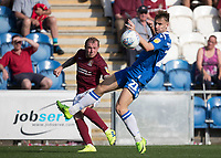 Nicky Adams of Northampton Town crosses beyond Ryan Camplin of Colchester United during Colchester United vs Northampton Town, Sky Bet EFL League 2 Football at the JobServe Community Stadium on 24th August 2019