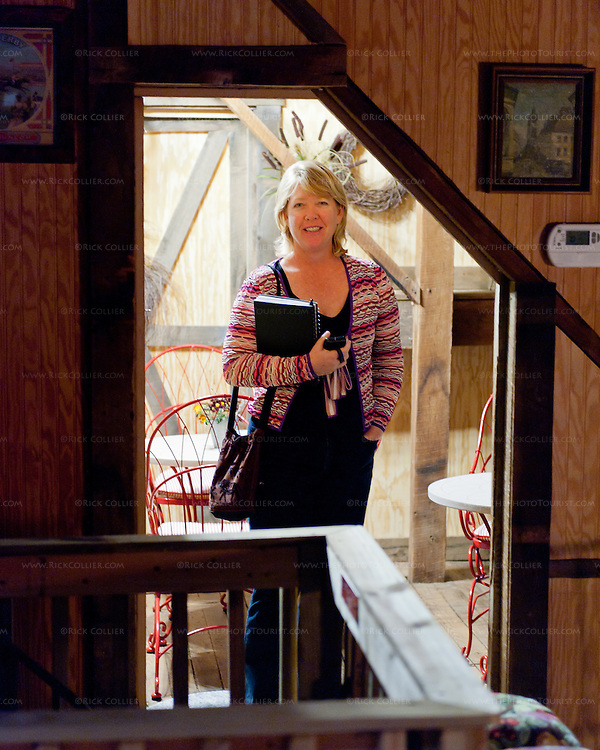 Nancy pauses in the member's lounge, upstairs at Aspen Dale Winery.