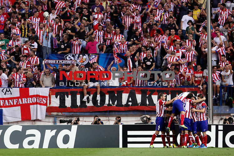 Atletico de Madrid's celebrate a goal during Champions League 2013/2014 match.September 18,2013. Foto © nph / Victor Blanco)