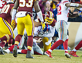New York Giants quarterback Eli Manning (10) is sacked by Washington Redskins offensive tackle Kevin Bowen (72) in the fourth quarter against the Washington Redskins at FedEx Field in Landover, Maryland on Thursday, November 23, 2017.  The Redskins won the game 20 - 10.<br /> Credit: Ron Sachs / CNP<br /> (RESTRICTION: NO New York or New Jersey Newspapers or newspapers within a 75 mile radius of New York City)