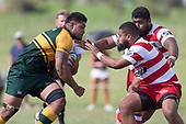 Vil;iami Tolutau Vake makes a determined run towards the Salesitongi Savelio and Tahu Hollis. Counties Manukau Premier Counties Power Club Rugby game between Karaka and Pukekohe, played at the Karaka Sports Park on Saturday March 10th 2018. Pukekohe won the game 31 - 27 after trailing 5 - 20 at halftime.<br /> Photo by Richard Spranger.