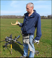 BNPS.co.uk (01202 558833)<br /> Pic: RogerGuttridge/BNPS<br /> <br /> David can't believe his eyes...<br /> <br /> 3500 year old solid gold torc found in a Dorset field.<br /> <br /> A peckish metal detectorist struck gold after leaving his machine on by accident as he went off for his lunchtime sandwich.<br /> <br /> David Spohr had given up after a fruitless morning searching the Tarrant Valley in Dorset and was walking to get his sandwiches when his metal detector went off.<br /> <br /> Curious to know what had triggered the detector he started digging and soon spotted a dull metal object which at first he thought was a rusty old sardine tin.<br /> <br /> But as he dug deeper he realised it was more than it first appeared - and after wiping the mud off it up he was shocked to find it was made from solid gold.<br /> <br /> Amazingly, the unremarkable lump was revealed to be a gold lunula, a crescent-shaped necklace dating back to the Bronze Age.<br /> <br /> Lunulas were worn by ancient tribal leaders as a symbol of power and authority.<br /> <br /> The lunula David found, which weighs 71.5 grams, is one of only a handful dug up in mainland Britain and is thought to be the first discovered using a metal detector.