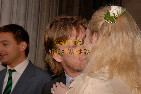 SEAN BEAN & GEORGINA SUTCLIFFE.Outside Marylebone Registry Office after their marriage ceremony, London, England, February 19th 2008..Wedding married getting hitched couple husband wife fourth time 4th portrait headshot bride groom confetti register kissing kiss.CAP/IA.?Ian Allis/Capital Pictures