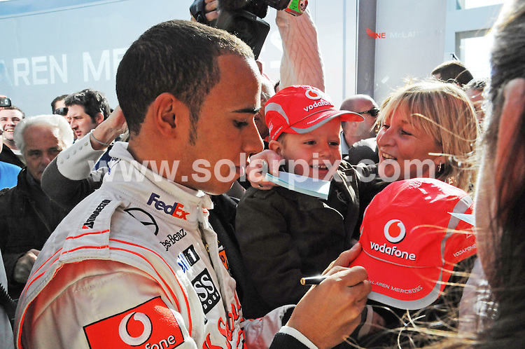 **ALL ROUND PICTURES FROM SOLARPIX.COM**.**WORLDWIDE SYNDICATION RIGHTS**.Lewis Hamilton got behind the wheel of his new F1 car, the MP4-24 for the first time this morning at the new Algarve Motor Park (Autodromo Internacional do Algarve) circuit in Portugal for Vodafone McLaren Mercedes..This pic: Lewis Hamilton signs autographs taking a break from driving due to a competitors car catching fire during testing..JOB REF:   8274     PPL        DATE: 21.01.09.**MUST CREDIT SOLARPIX.COM OR DOUBLE FEE WILL BE CHARGED* *UNDER NO CIRCUMSTANCES IS THIS IMAGE TO BE REPRODUCED FOR ANY ONLINE EDITION WITHOUT PRIOR PERMISSION*
