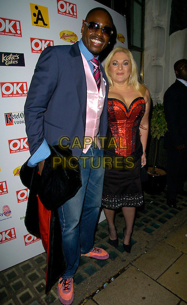 BEN OFOEDU & VANESSA FELTZ.At the OK! Magazine Christmas Party, Jewel, Piccadilly, London, UK. .December 5th 2006.full length blue suit jacket jeans denim red sequins strapless top bustier corset skirt black sunglasses shades.CAP/CAN.©Can Nguyen/Capital Pictures