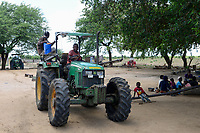 ZAMBIA, Mazabuka, Chikankata area, medium scale farmer Stephen Chinyama, homestead with John Deere tractor