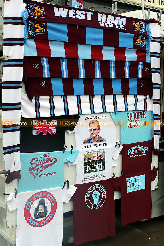 West Ham scarves and East End t-shirts on sale outside the ground - West Ham United vs Hull City - Barclays Premier League Football at the Boleyn Ground, Upton Park, London - 18/01/15 - MANDATORY CREDIT: Paul Dennis/TGSPHOTO - Self billing applies where appropriate - contact@tgsphoto.co.uk - NO UNPAID USE