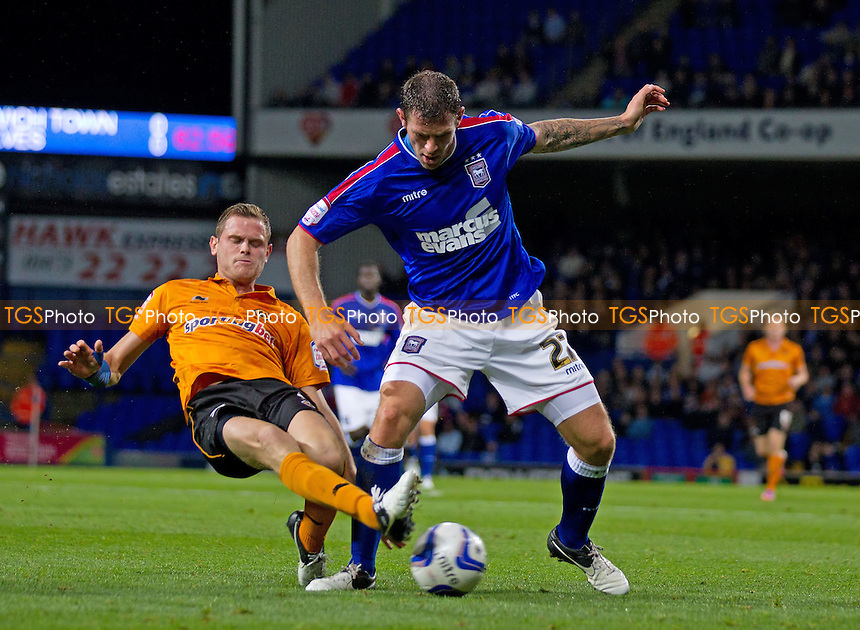 Daryl Murphy, Ipswich Town FC comes under pressure from Richard Stearman, Wolverhampton Wanderers FC - Ipswich Town vs Wolverhampton Wanderers - NPower Championship Football at Portman Road, Ipswich, Suffolk - 19/09/12 - MANDATORY CREDIT: Ray Lawrence/TGSPHOTO - Self billing applies where appropriate - 0845 094 6026 - contact@tgsphoto.co.uk - NO UNPAID USE.