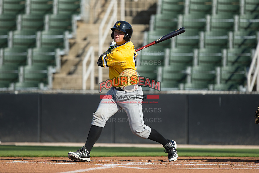 Taylor Gushue (17) of the West Virginia Power follows through on his swing against the Kannapolis Intimidators at CMC-Northeast Stadium on April 21, 2015 in Kannapolis, North Carolina.  The Power defeated the Intimidators 5-3 in game one of a double-header.  (Brian Westerholt/Four Seam Images)