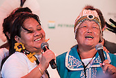 Alexandra Grigorieva, the single delegate from Siberia, sings with a Terena woman during a cultural event at the International Indigenous Games, in the city of Palmas, Tocantins State, Brazil. Photo © Sue Cunningham, pictures@scphotographic.com 29th October 2015